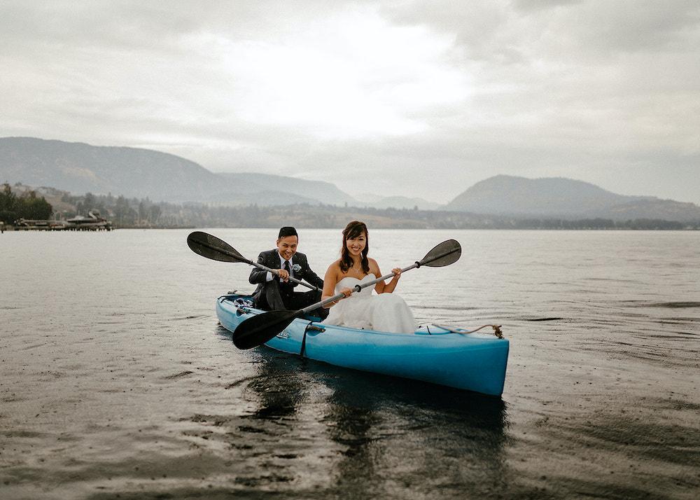 Newlyweds paddle canoe across lake in Okanagan