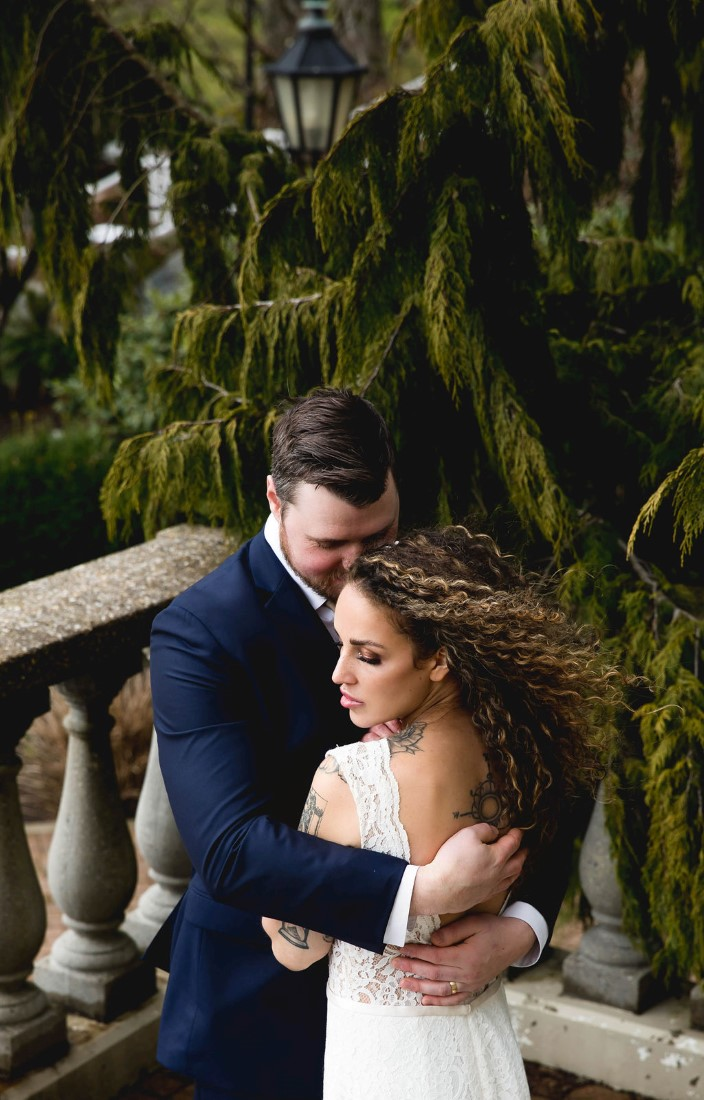 Bohemian Inspired Elopement couple embrace with bride's hair blowing in the wind