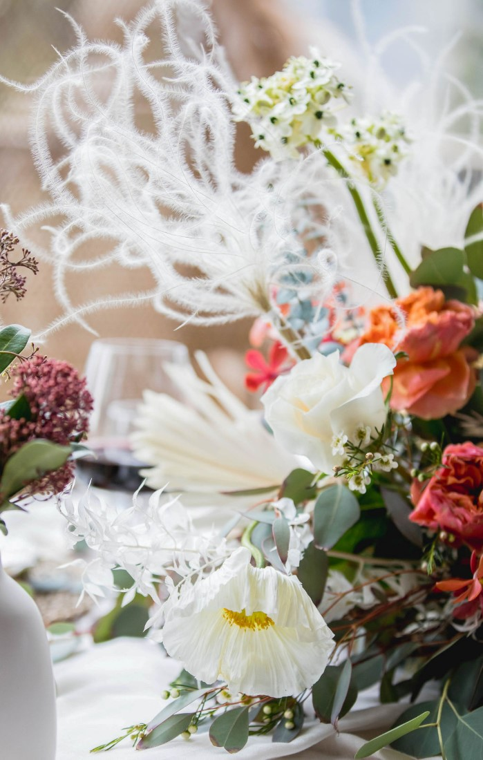 Peach, pink and white flowers on wedding sweetheart reception table