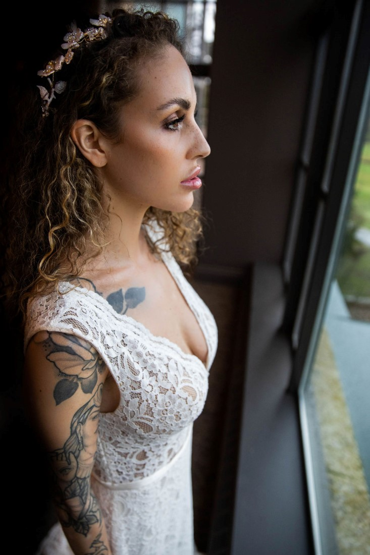 Bride with tattoos in bridal gown by Isabelle's Bridal Vancouver