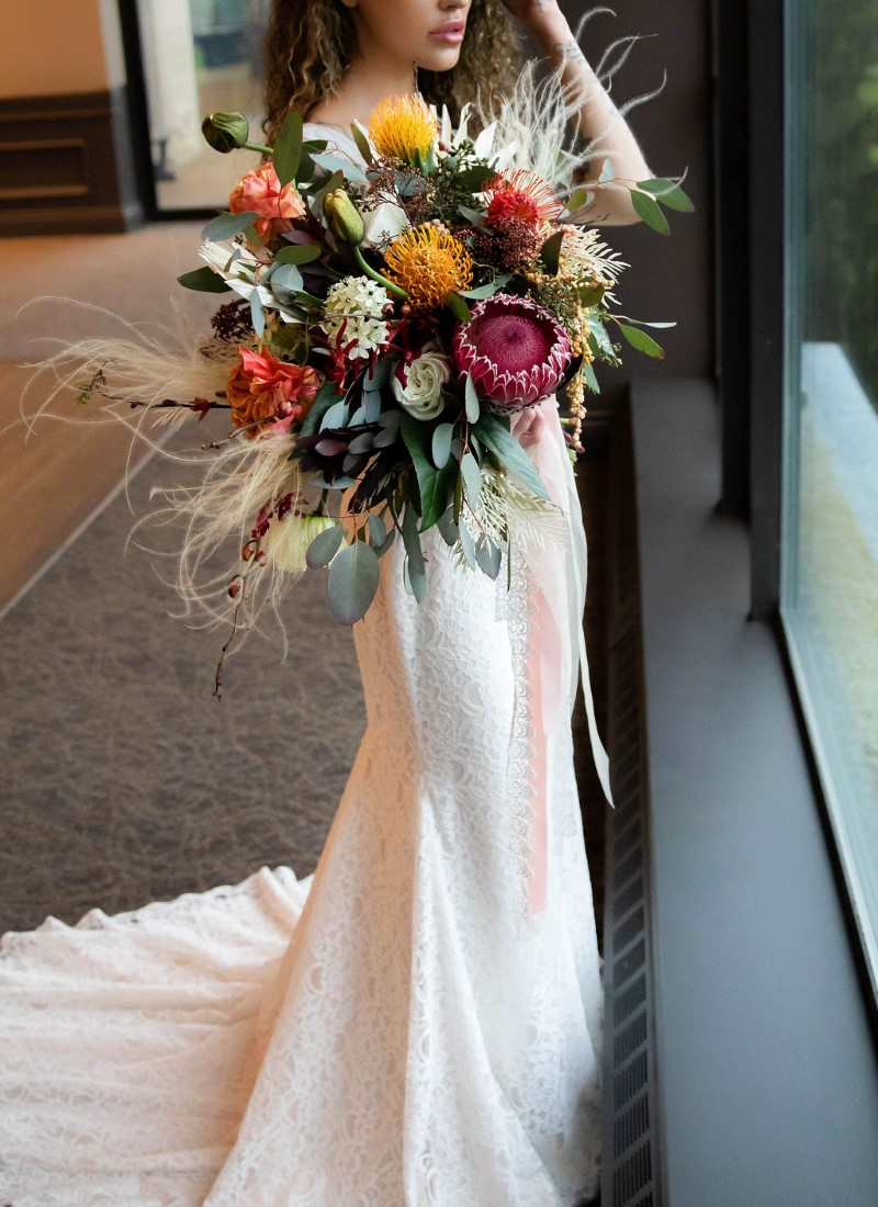 Stunning bridal bouquet of protea and yellow roses by Maple Ridge Floral Ltd Vancouver