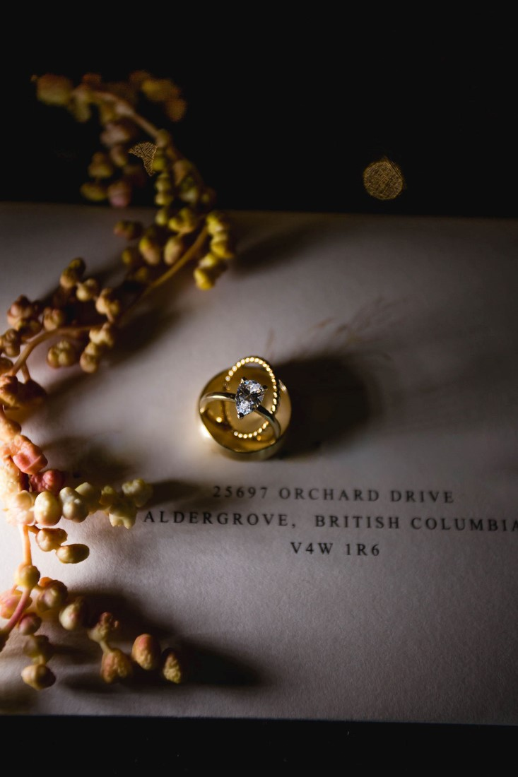 Rings by Cavalier Gastown Vancouver sit on invitation by Paper Poet