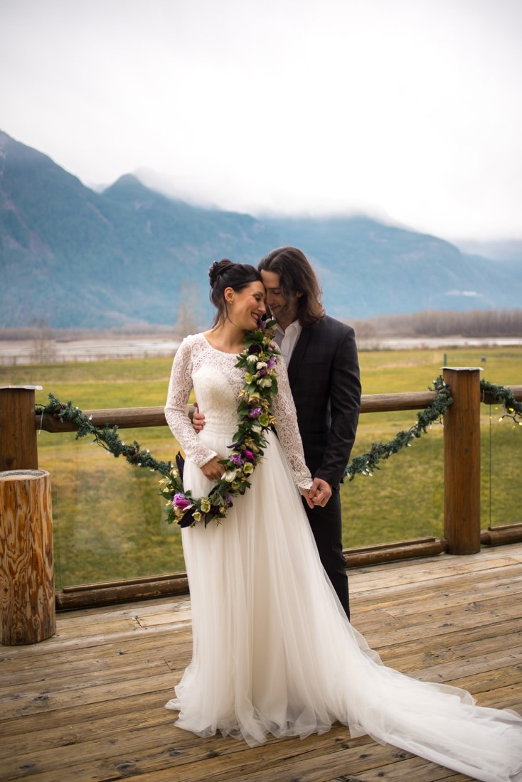 Cozy Elopement Inspiration couple in front of mountains
