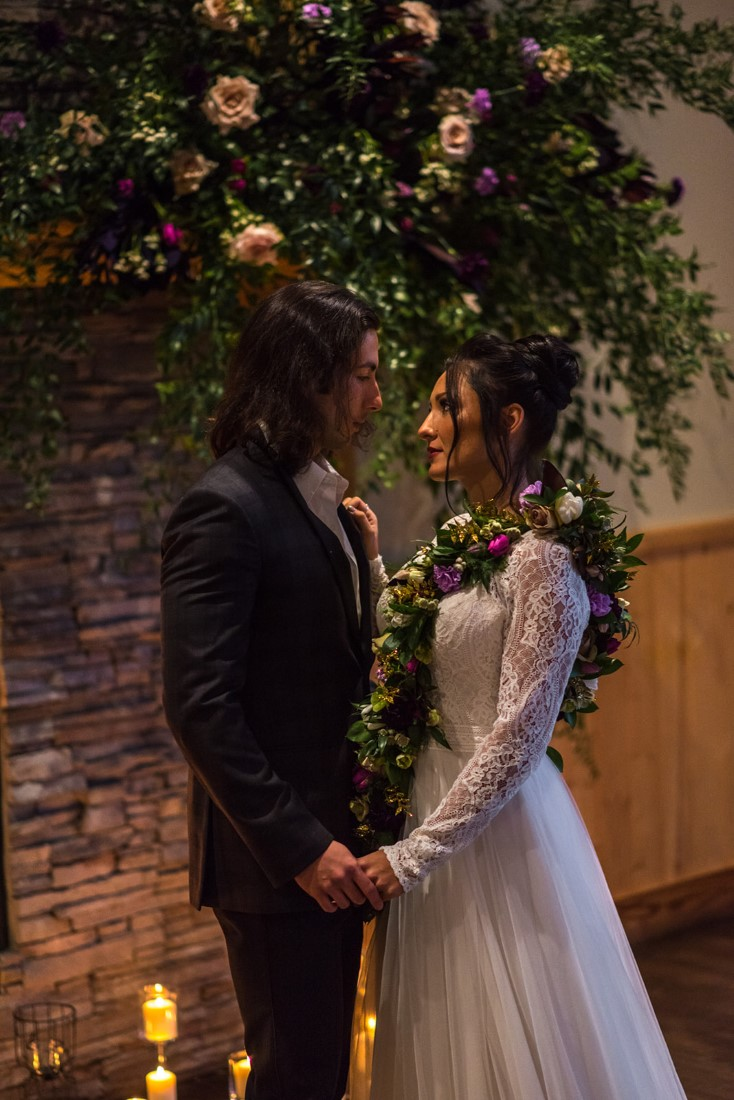 Bride and groom with floral necklace