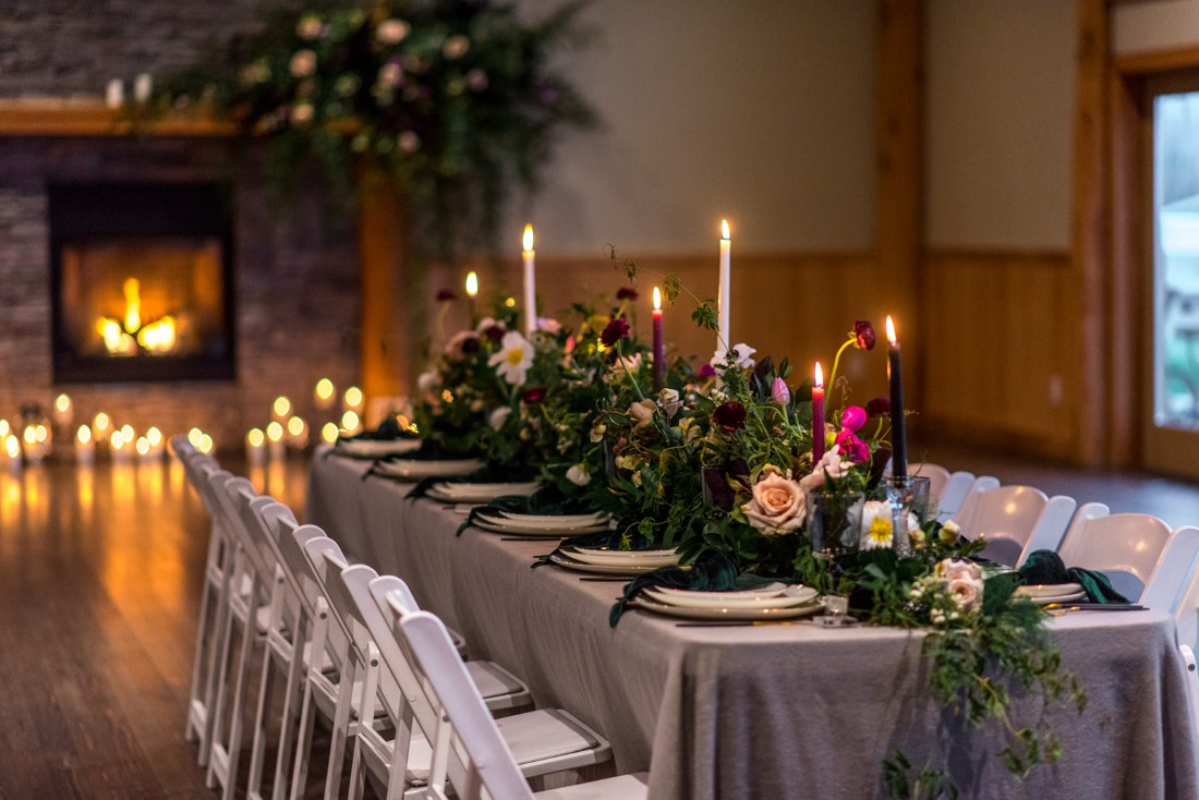 Wedding reception table with candlesticks and flowers by All Her Flowers and Winston Table Curations