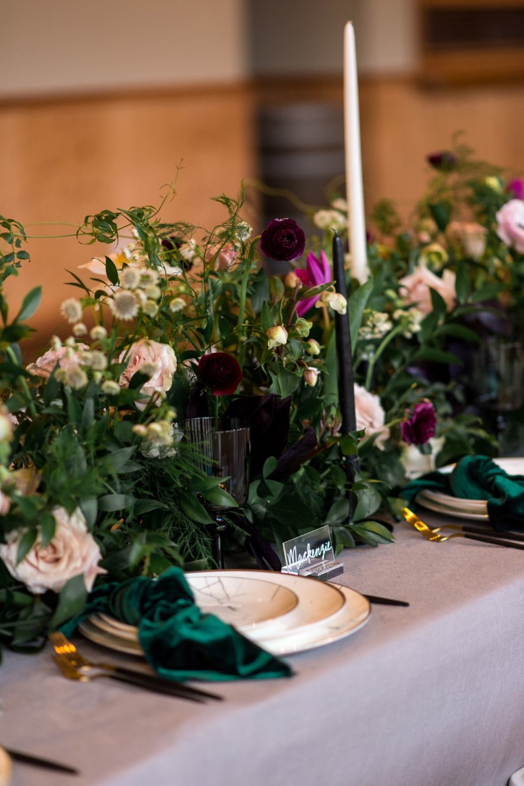 Wedding Reception talbe with greenery and roses and tall candlesticks by All Her Flowers Fraser Valley