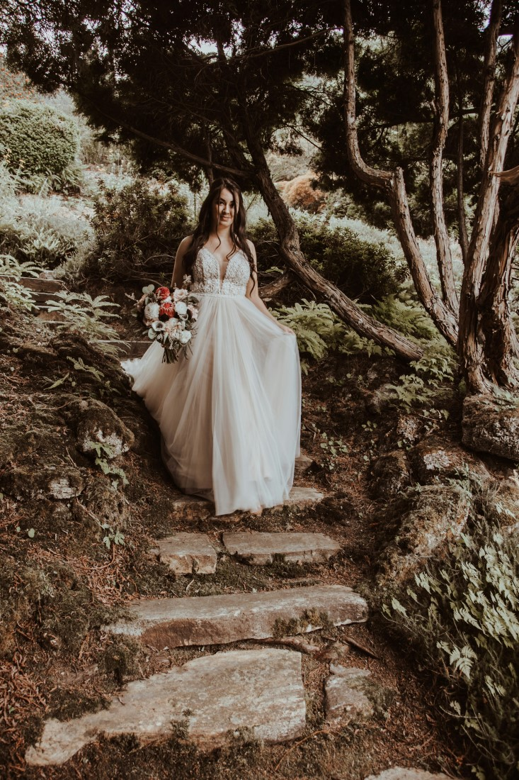 Bride comes down the path to ceremony at Blaylock Mansion