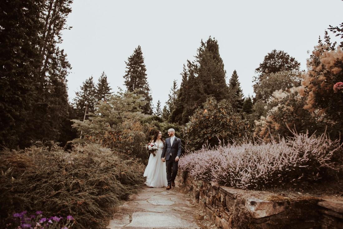 Newlyweds walk along garden paths of Blaylock Mansion