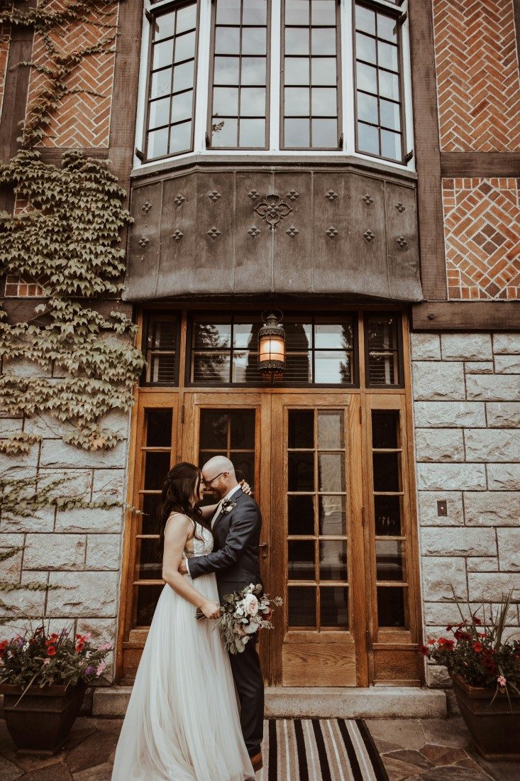 Newlyweds on the front steps of Blaylock Mansion
