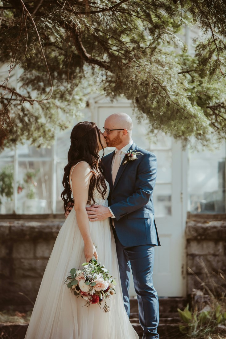 Bride and groom kiss after exchanging vows