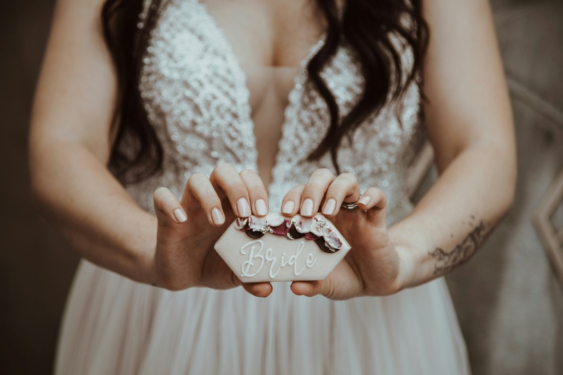Bride holds rings in her hand