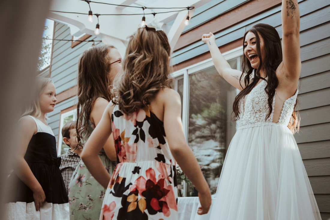 Bride greets her friends with great enthusiasm at wedding reception
