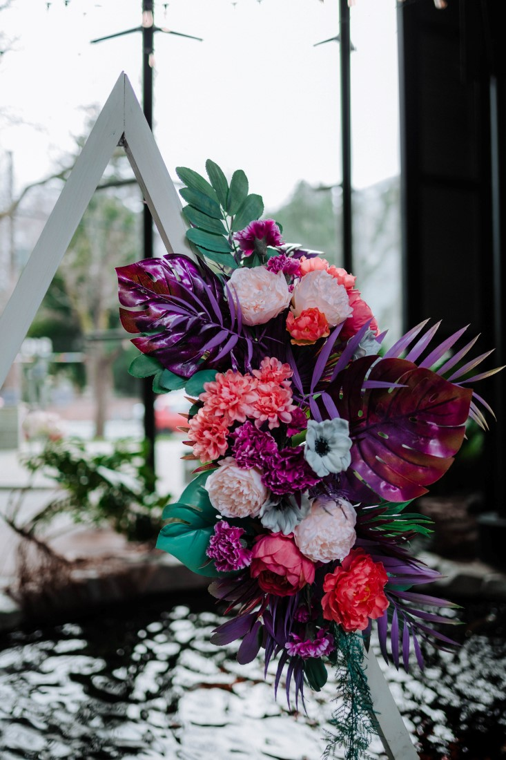Palm leaves, anemone, peonies and carnation floral arrangement by En Vied Events