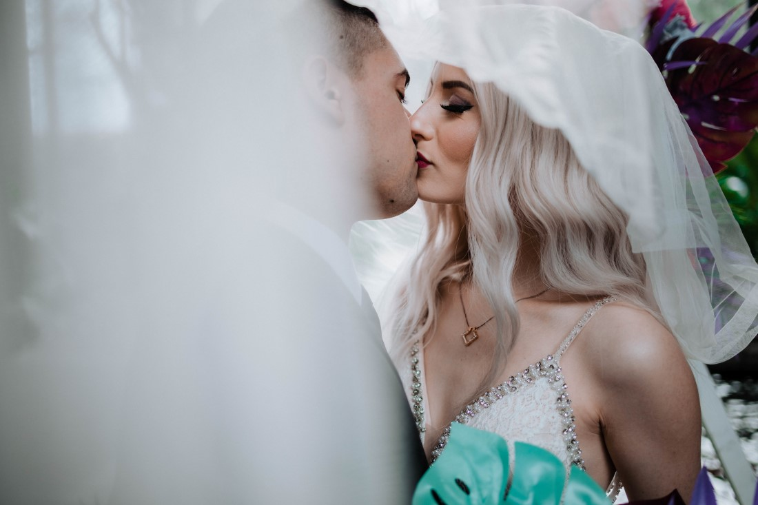Elopement Giveaway newlyweds kiss at Parkside Hotel by Megan Maundrell Photography