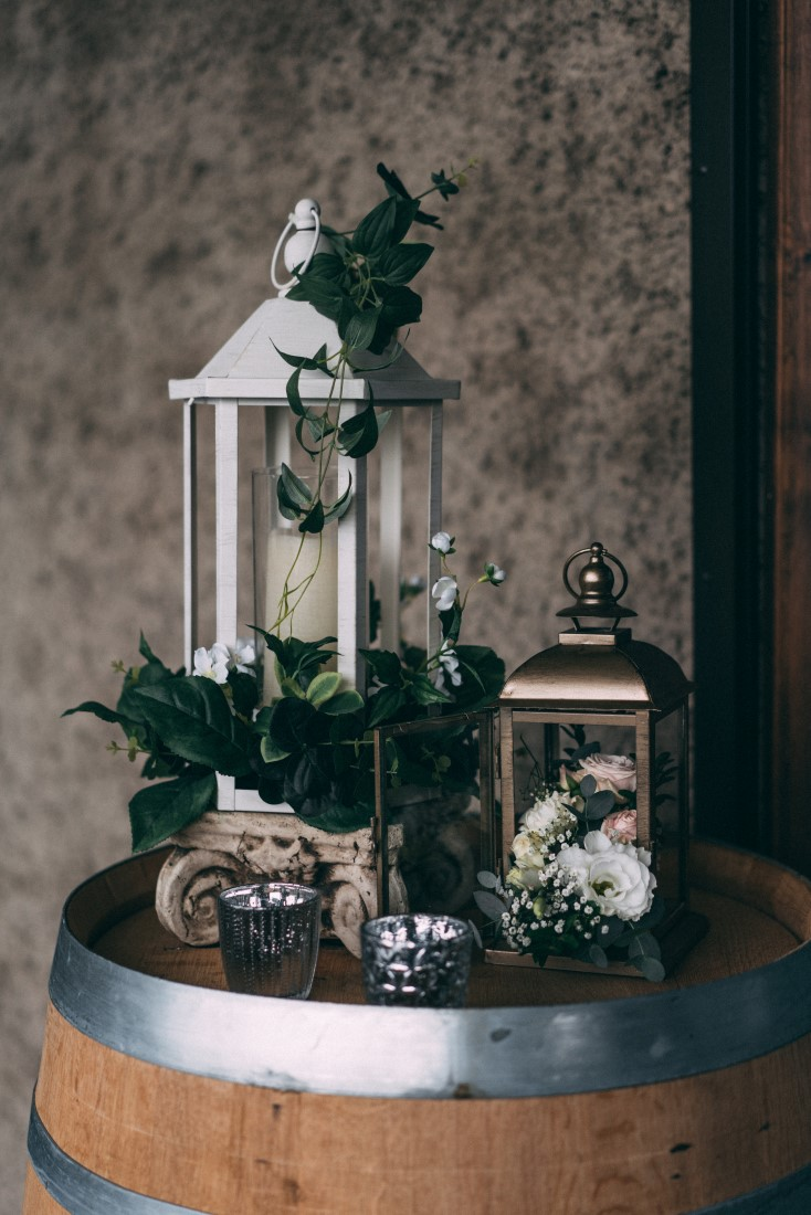 Silver lanterns with greenery by The Little Wedding Shoppe Vancouver