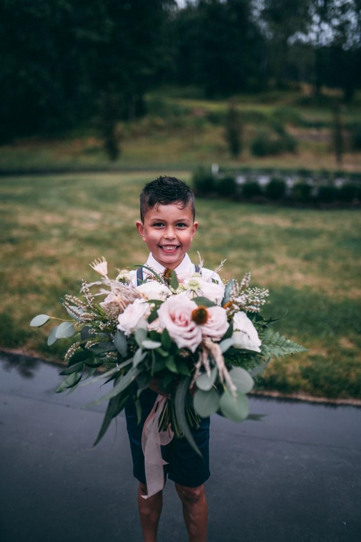 Little boy holds bouquet by AJR Floral Design Vancouver