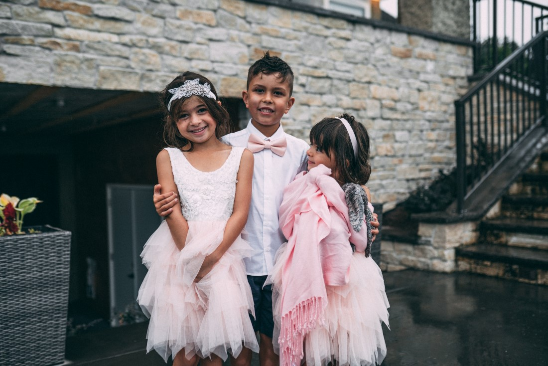 Flower girls and usher in pink and white