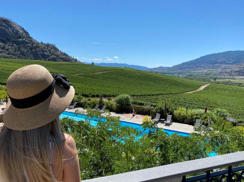 Honeymooner looks out over pool at Burrowing Owl Estate Winery Okanagan