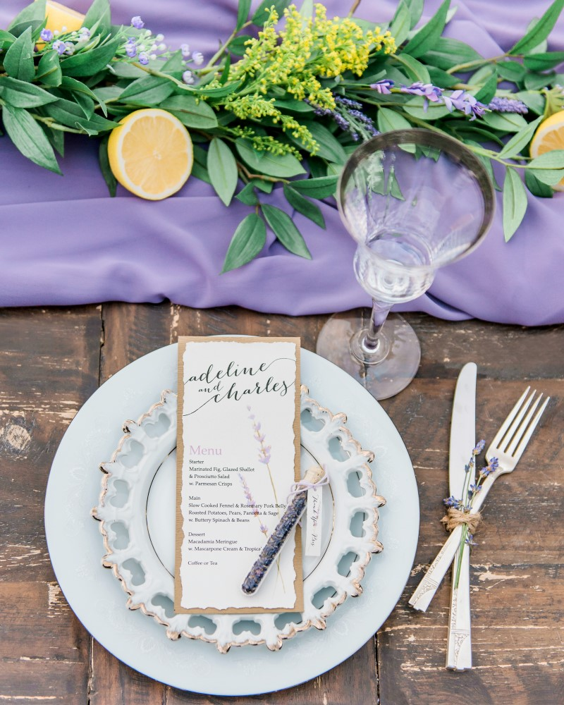 Lavender runner on wedding reception table with antique tableware
