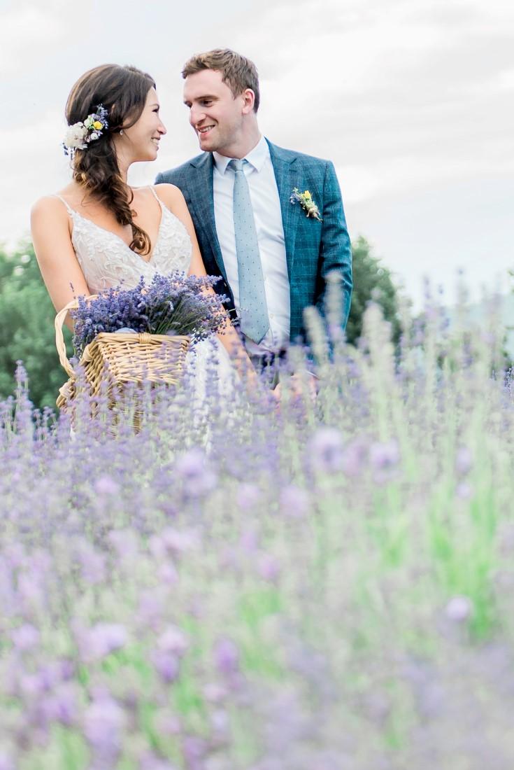 Wedding Lavender in Bloom bridal couple walk through field picking
