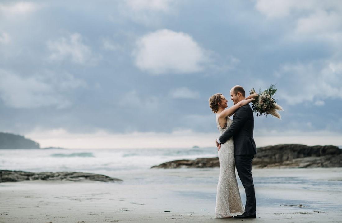 Tofino Beach Wedding couple embrace along the beach