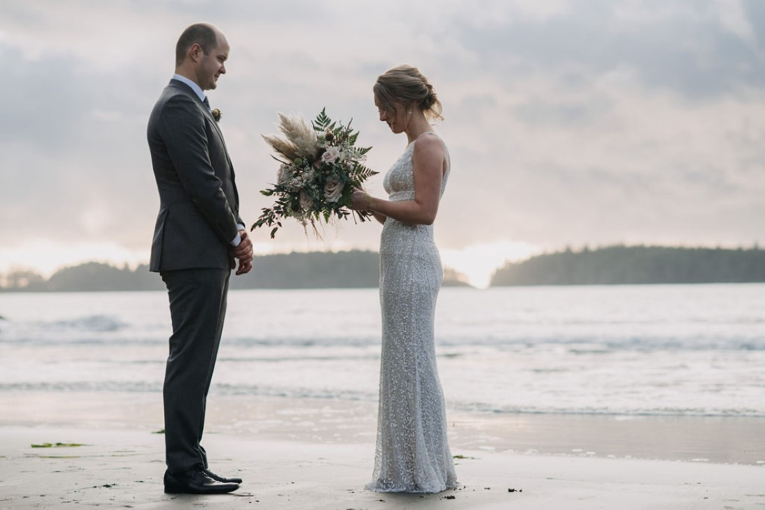 Bride gives vows to groom while eloping on Tofino beach