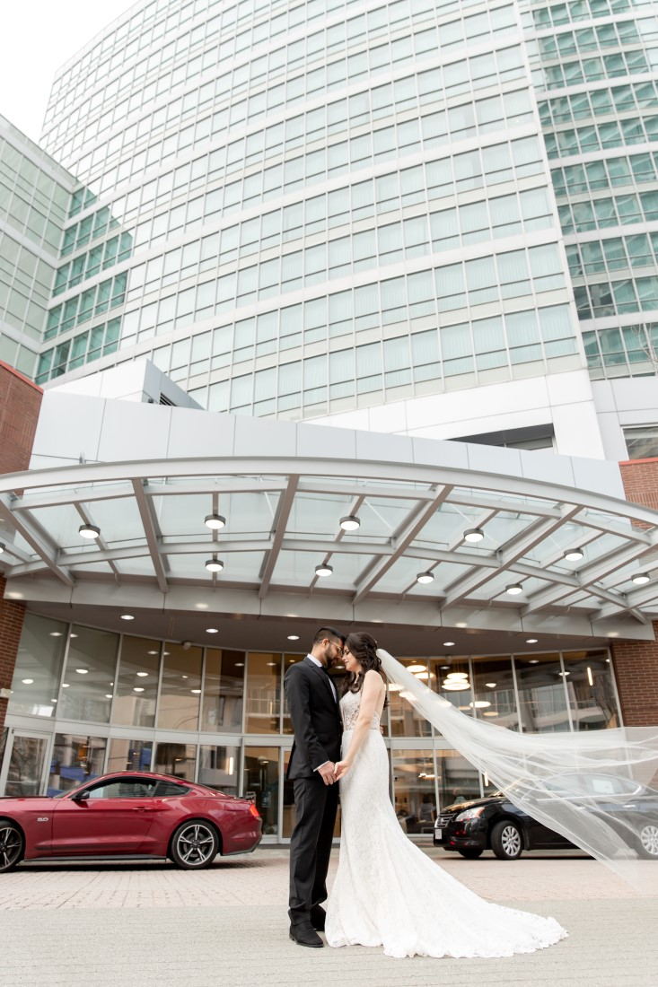Bridal Couple in front of Vancouver Hilton Metrotown