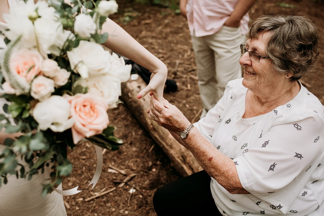 Bride receives gift from mother
