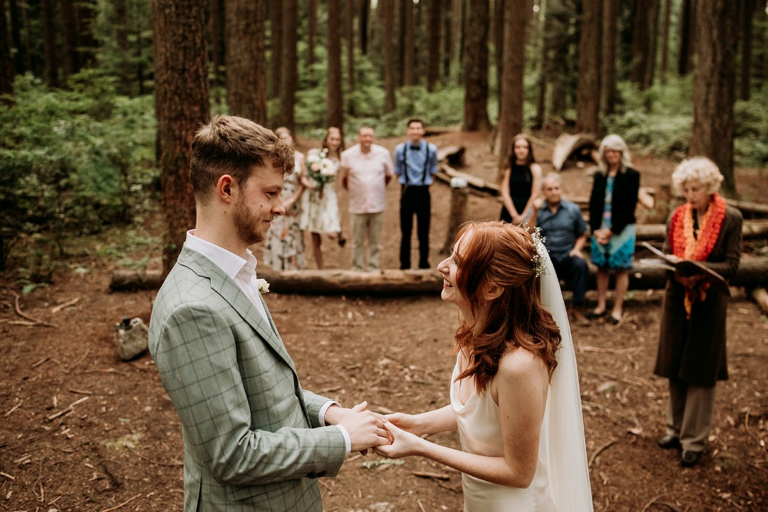 Guests look on as couple exchange vows in Vancouver forest elopement