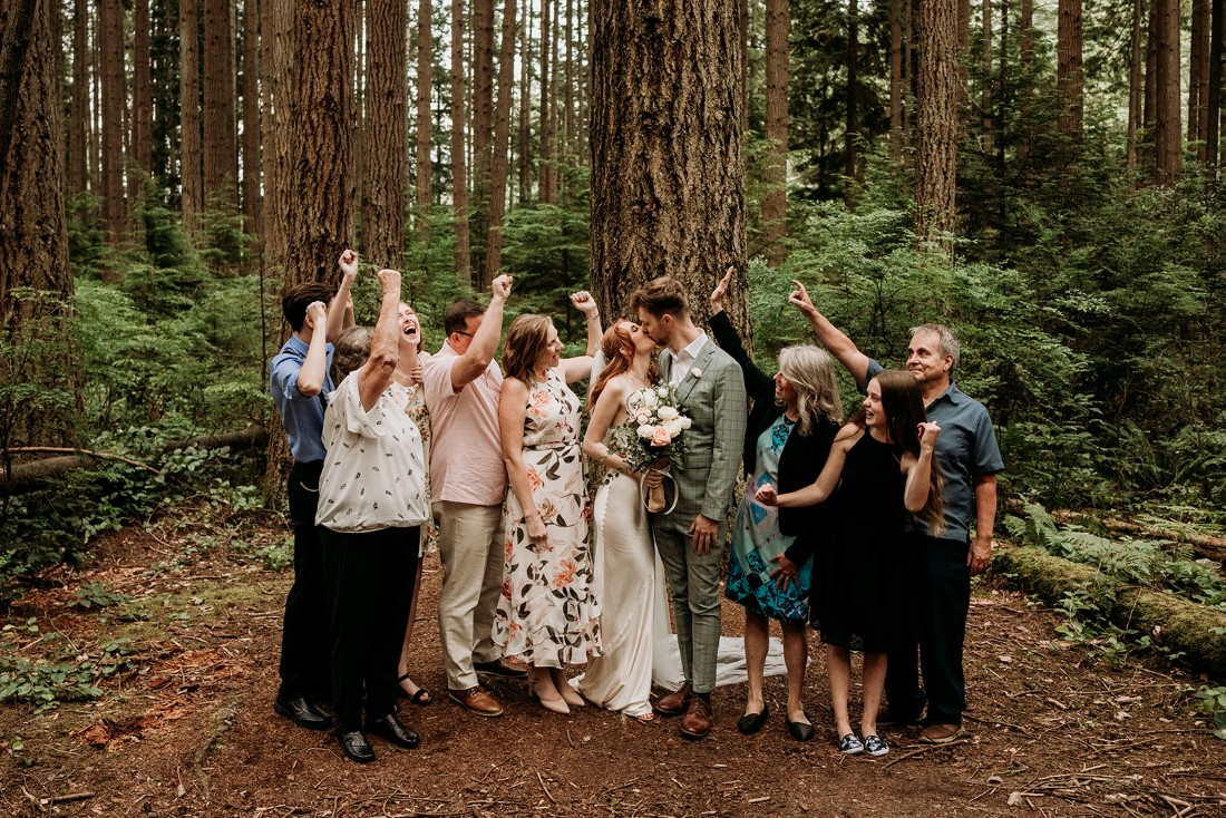 Heartfelt Elopement in Vancouver guests raise a glass to toast the newlyweds