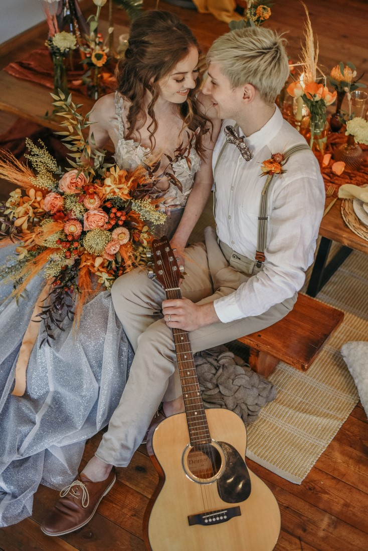 Deep Cove Winery Wedding Dayla Weiss Photo couple sitting with guitar