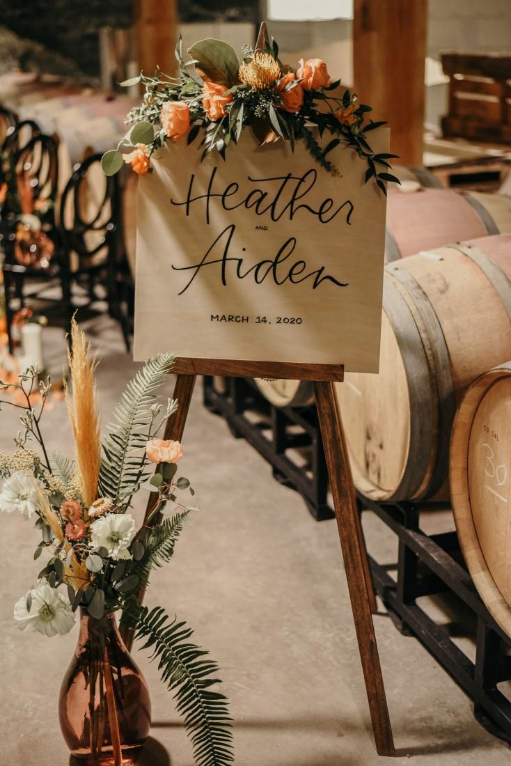 Deep Cove Winery Wedding Dayla Weiss Photo Wedding of couple announced on easel