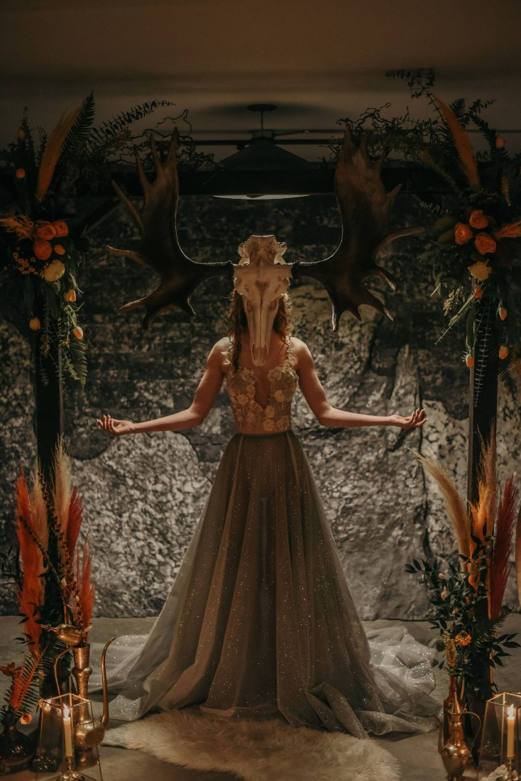 Deep Cove Winery Wedding Dayla Weiss Photo bride wearing scull with antlers