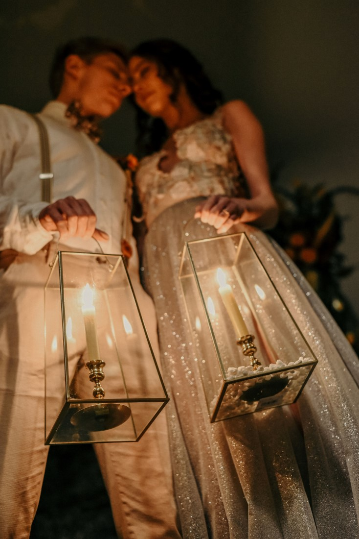 Deep Cove Winery Wedding Dayla Weiss Photo close up of bride and groom holding lit lanterns