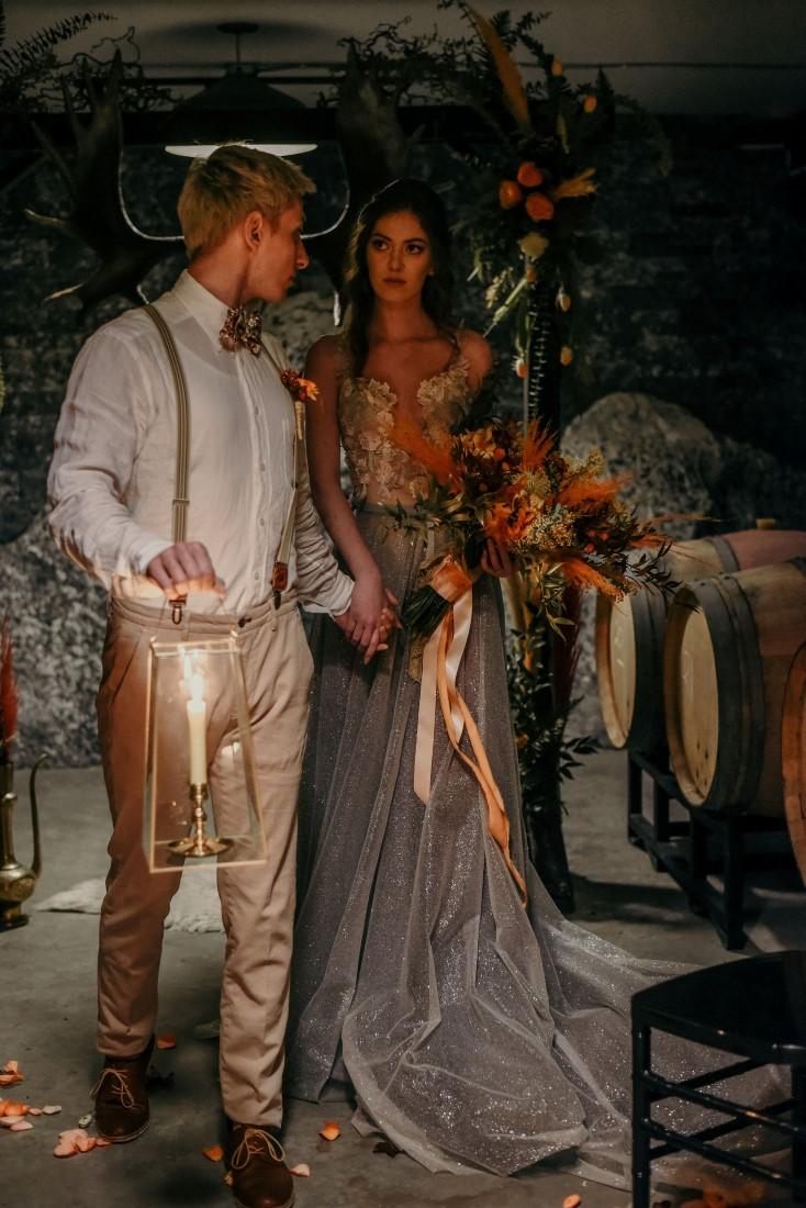 Deep Cove Winery Wedding Dayla Weiss Photo Bride and Groom walk down aisle with lantern