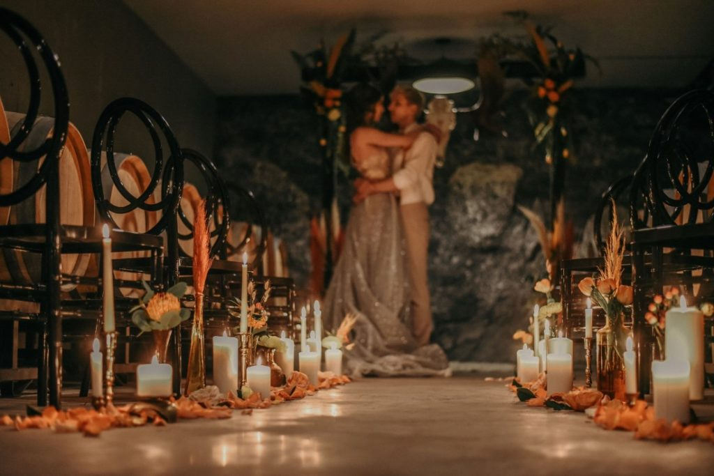 Deep Cove Winery Wedding Dayla Weiss Photo Candle lit aisle