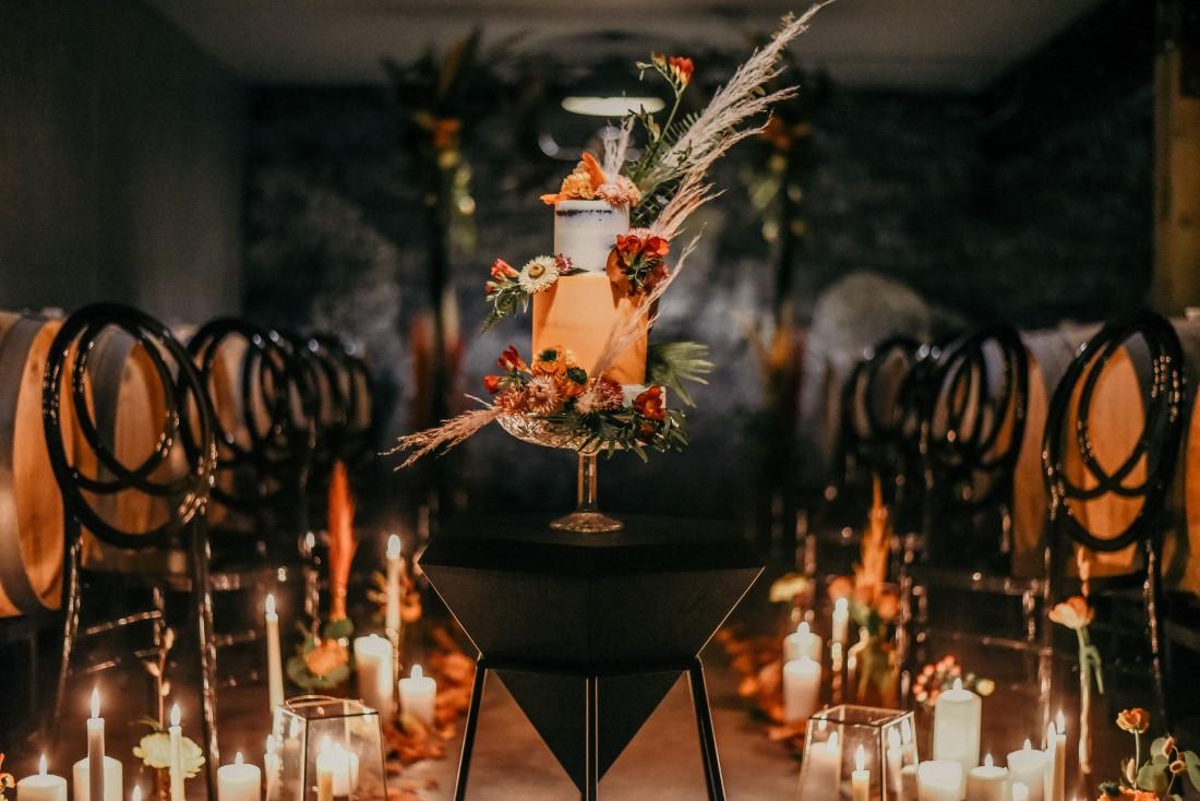 Deep Cove Winery Wedding Dayla Weiss Photo Wedding Cake showcased on crystal cakestand