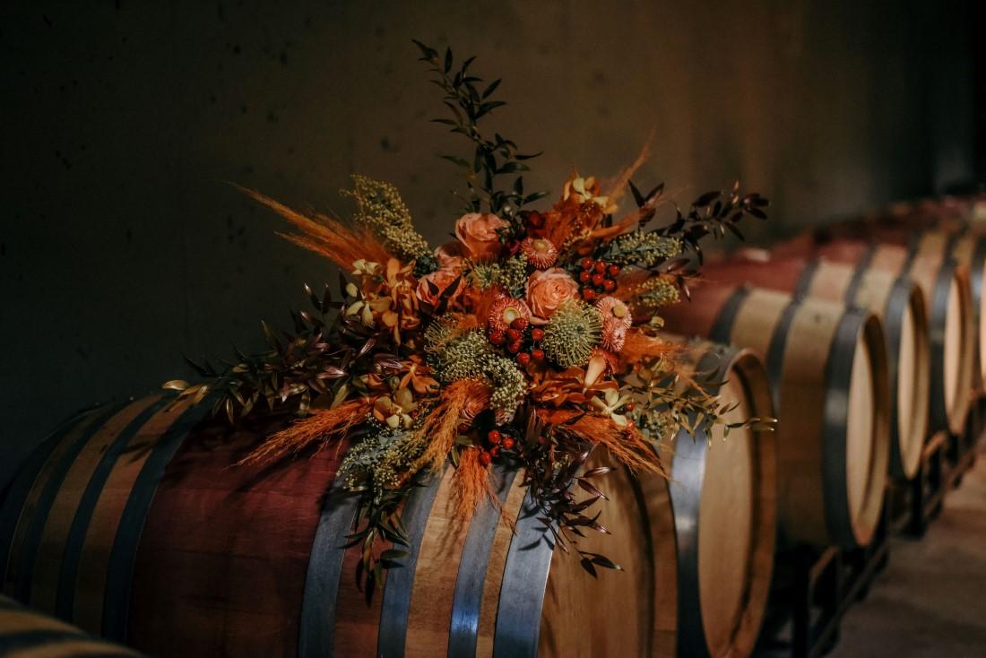 Deep Cove Winery Wedding Dayla Weiss Photo Bridal Bouquet on Wine Barrels