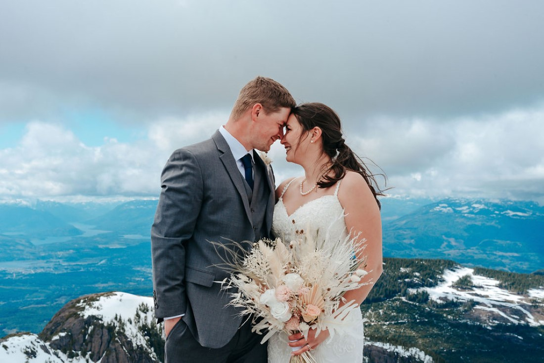 Wedding From Above Janayh Wright Photography sharing a moment on top of mountain