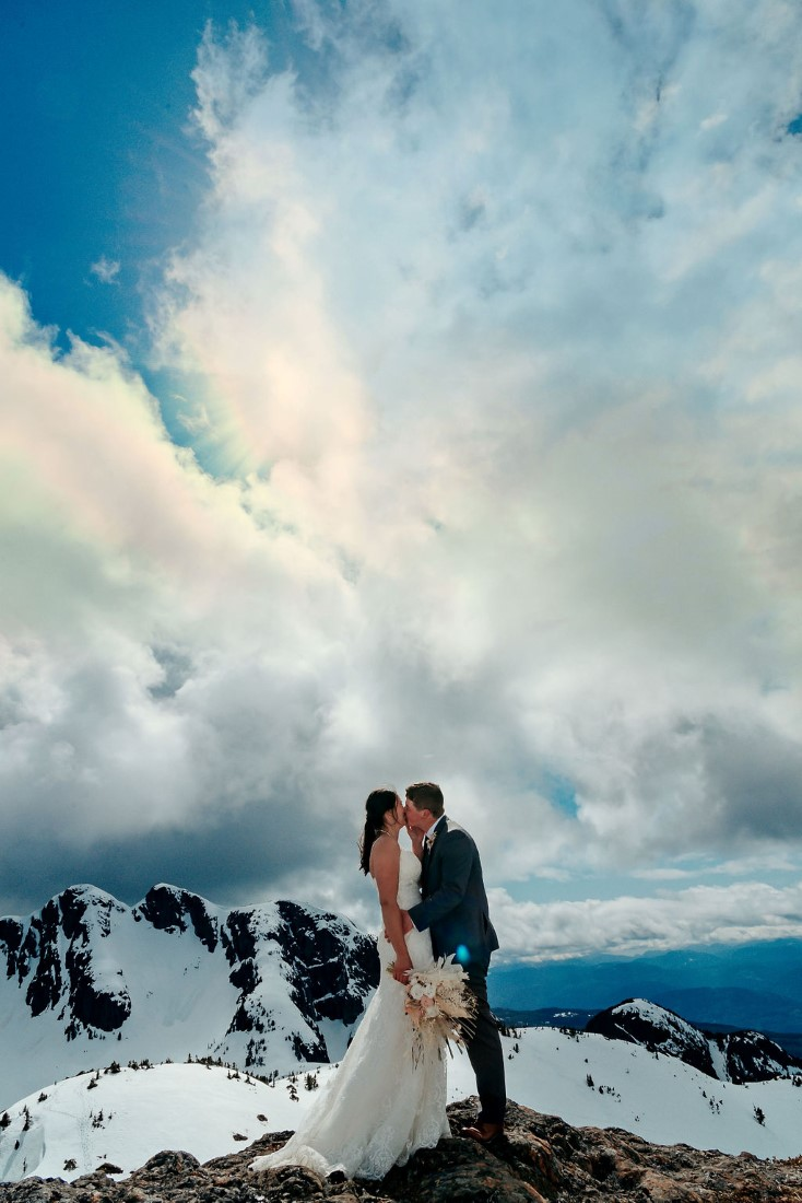 Wedding From Above Janayh Wright Photography mountaintop kisses