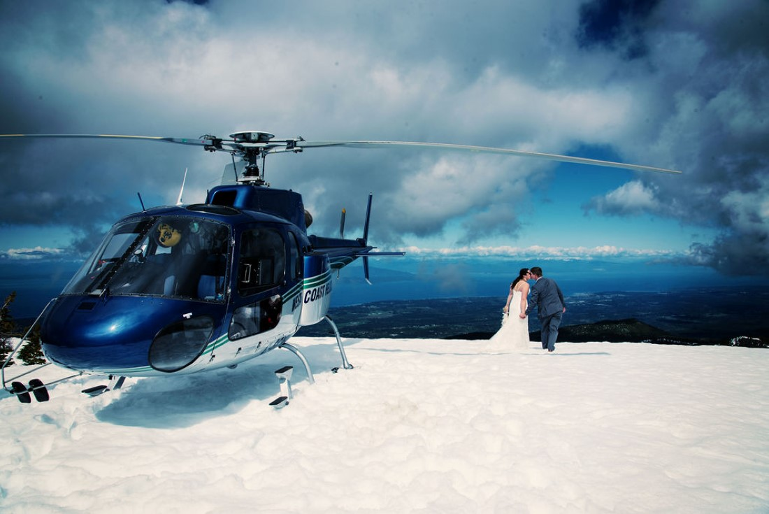Wedding From Above Janayh Wright Photography wedding kisses in the snow