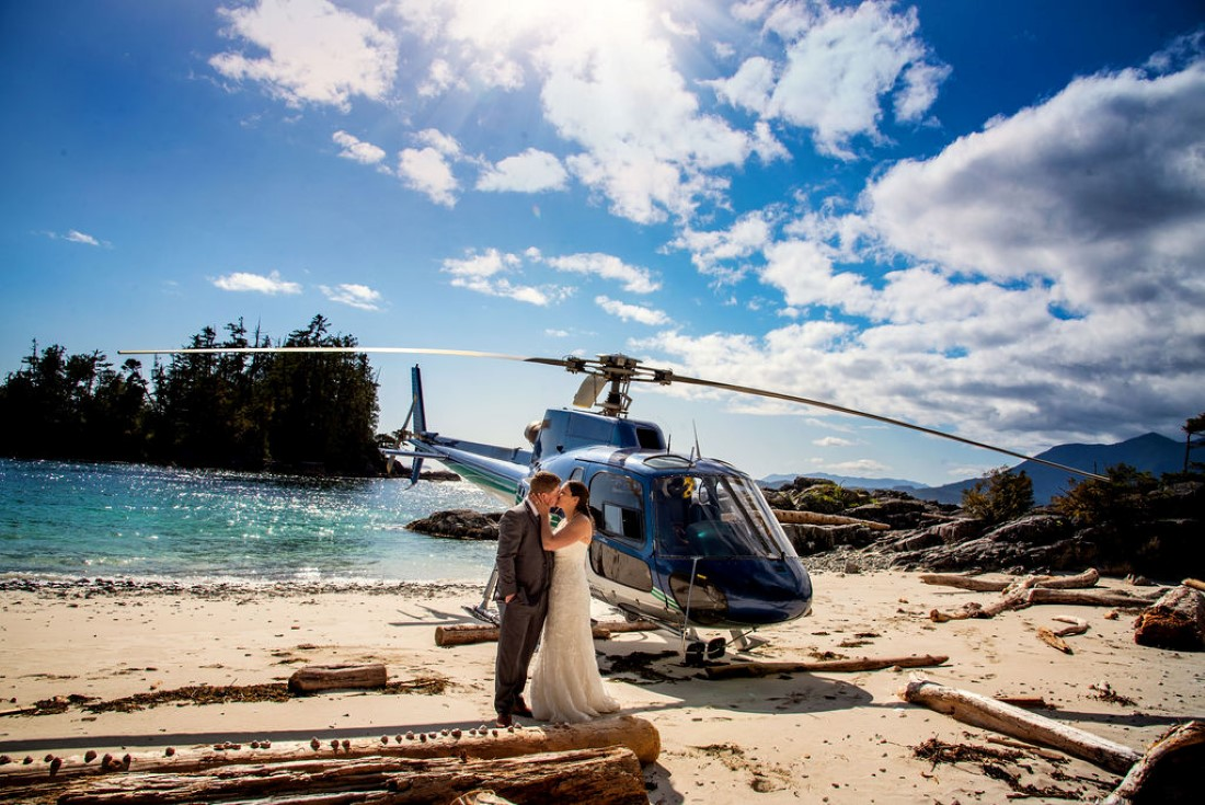 Wedding From Above Janayh Wright Photography couple kissing in front of helicopter