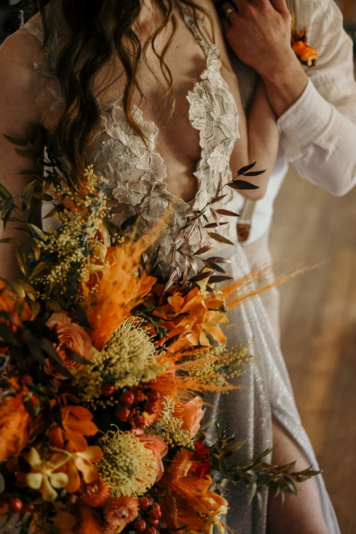 Deep Cove Winery Wedding Dayla Weiss Photo bride holding bouquet