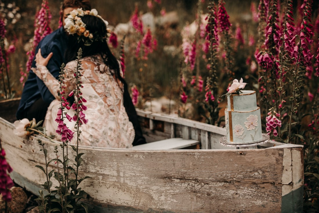 Foxgloves are Forever Island Moments Photography bride and groom boat embrace
