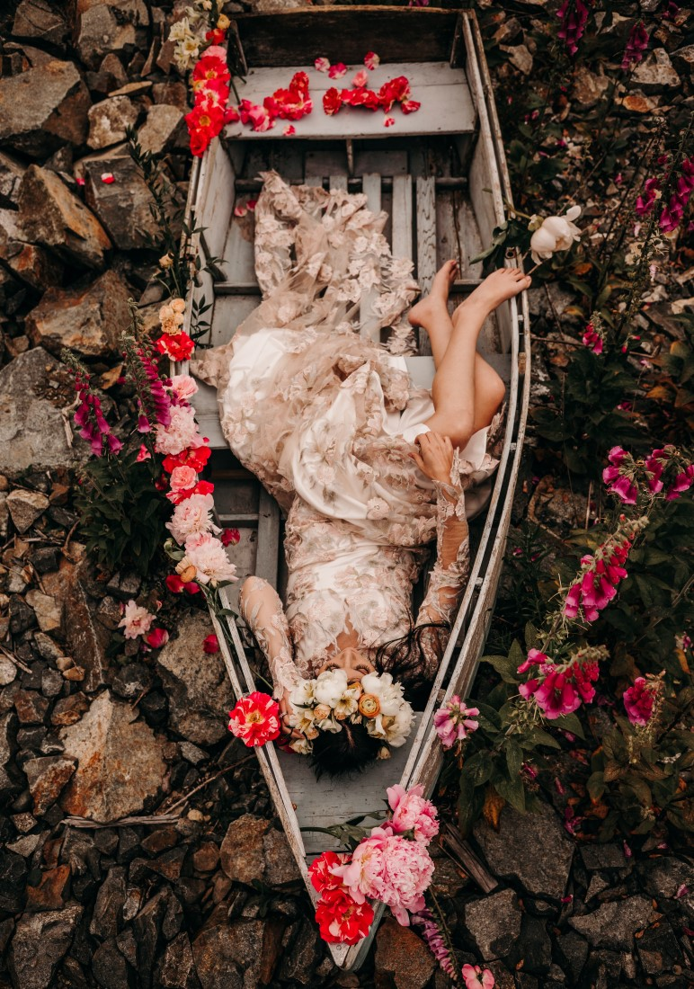 Foxgloves are Forever Island Moments Photography barelegged bride lays in boat