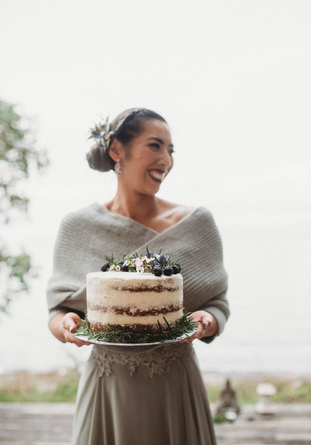 Changing Plans Anastasia Photography bride holding naked cake with evergreen