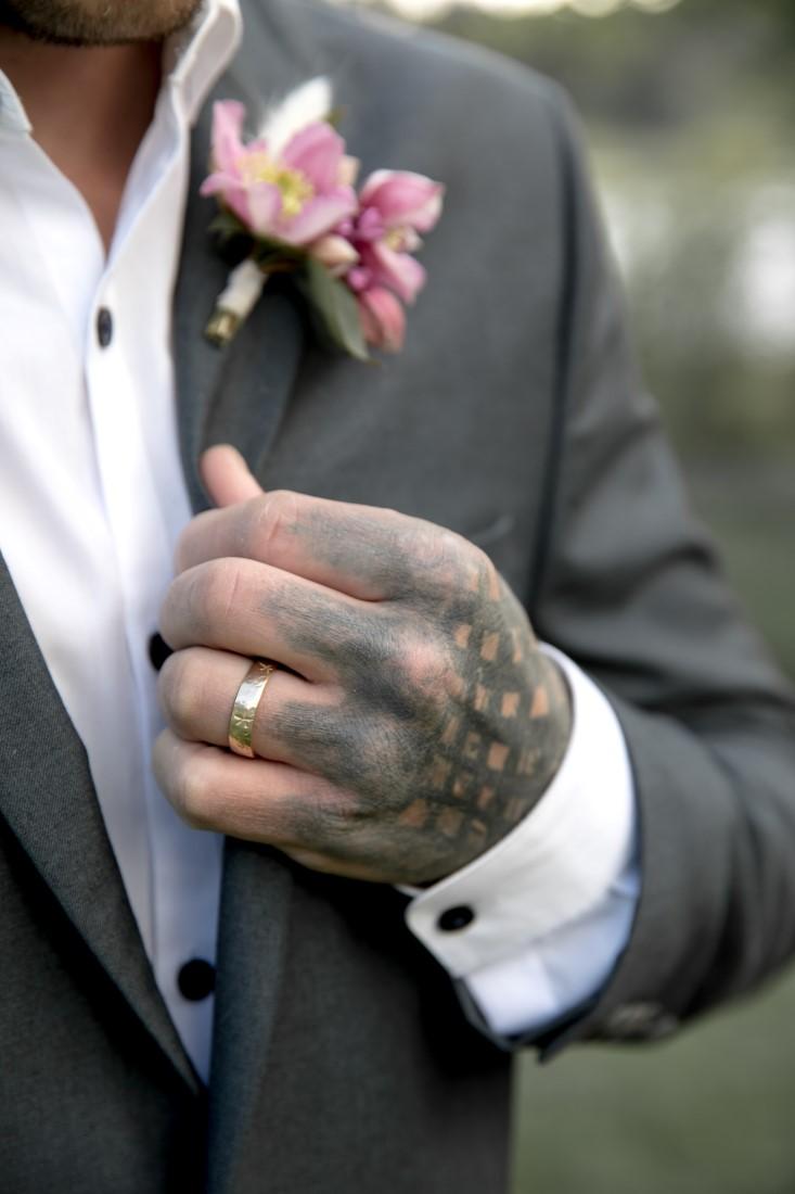 Purple Lilac Spring Wedding Hattie Root Photo groom wearing his ring