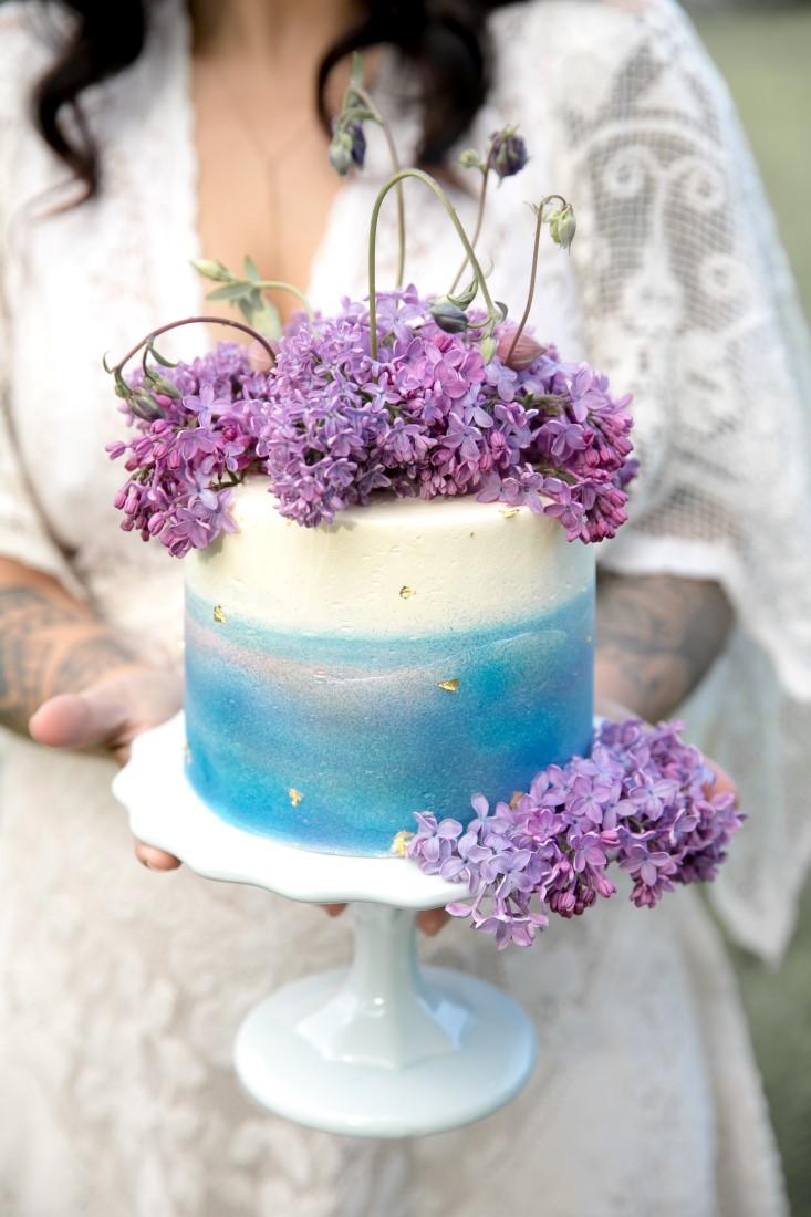 Purple Lilac Spring Wedding Hattie Root Photo bride holding Wedding cake
