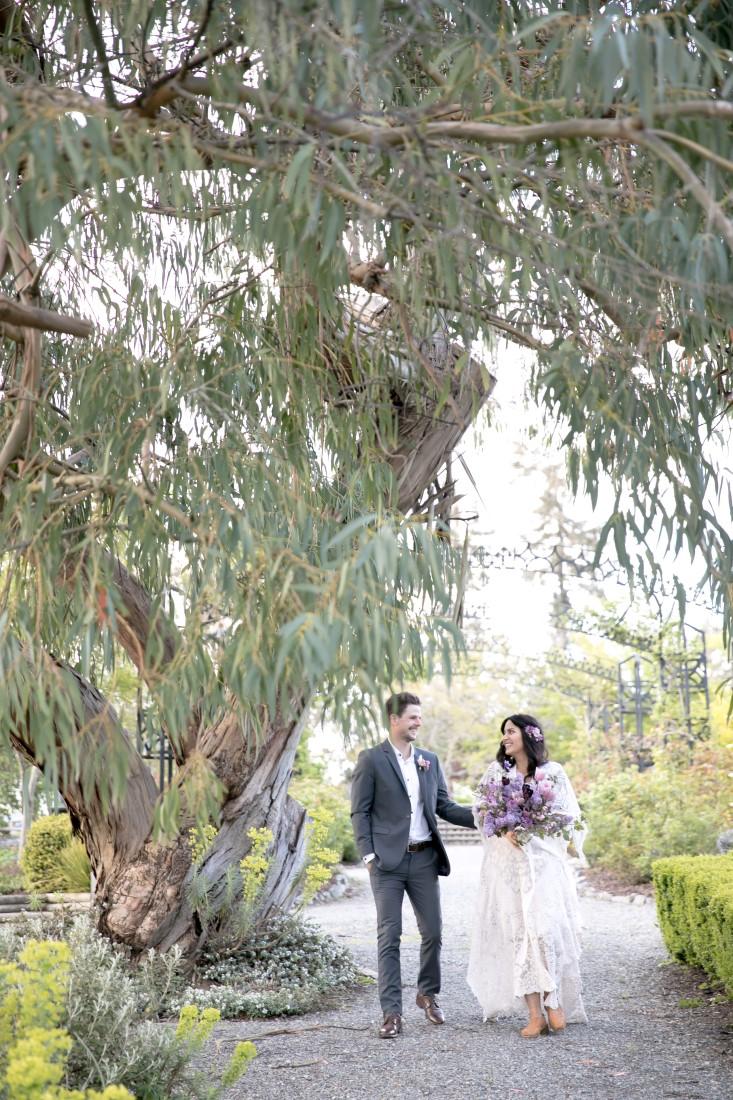 Purple Lilac Spring Wedding Hattie Root Photo couple walking in garden