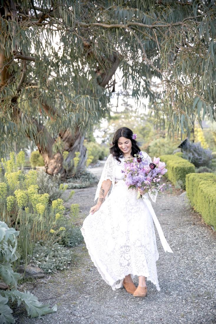 Purple Lilac Spring Wedding Hattie Root Photo bride walking in her gown